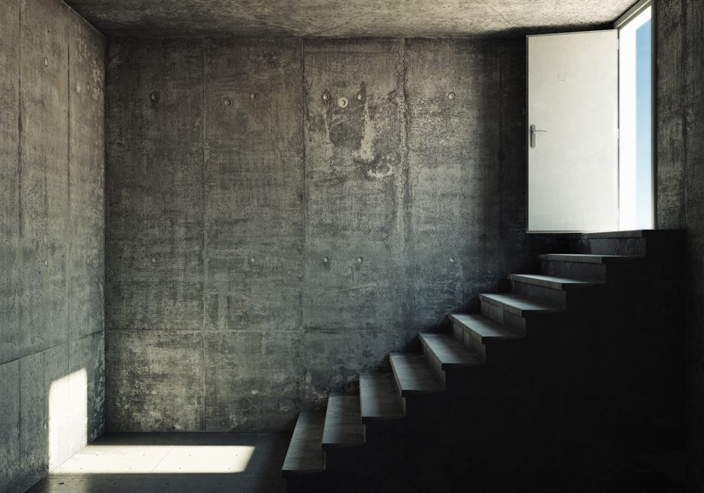 Interior room with concrete walls and stairs leading to the exit